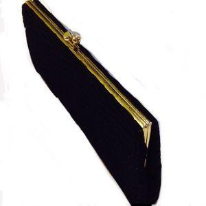 black textured fabric kiss lock clutch